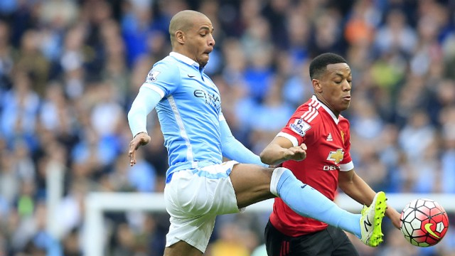 GETTING STUCK IN: Fernando did his bit but the derby was a day to forget for City