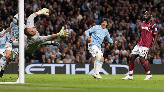 Carlos Tevez scores his second goal of the game