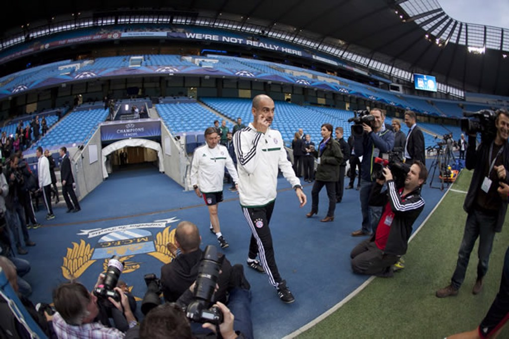AT THE ETIHAD: Pep visits with Bayern in 2013.