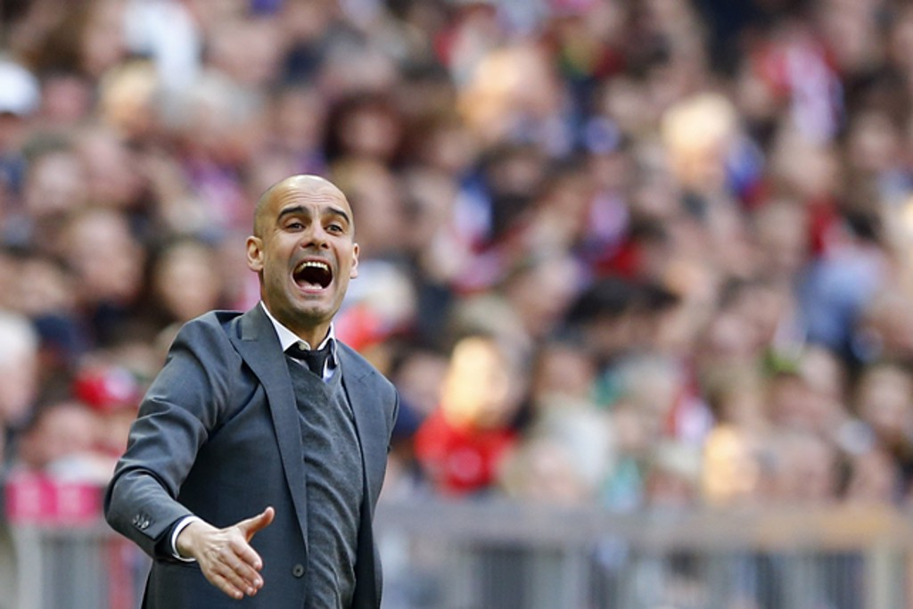 THE CONDUCTOR: Pep orchestrates from the sidelines