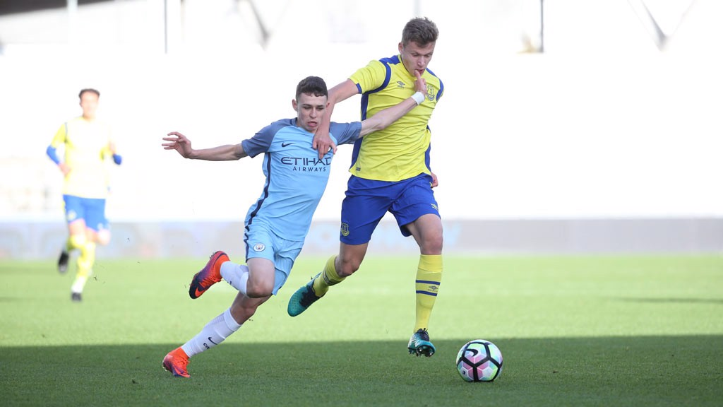 BATTLE: Phil Foden fights to regain posession