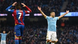 TRIUMPH AND DESPAIR: Sergio Aguero and Yohan Cabaye react to City's second