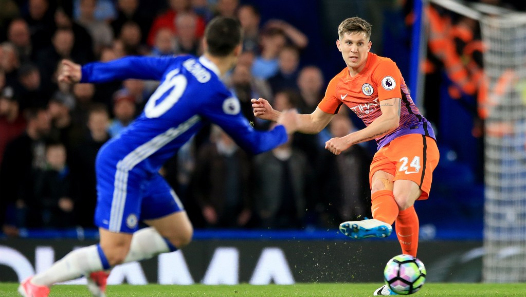 PRESSURE: Hazard looks to block John Stones' ball out.