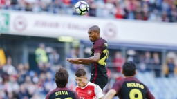 RISING HIGH: Fernandinho meets a header