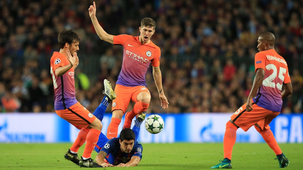 SURROUNDED: Manchester-City's trio David Silva, John Stones and Fernandinho in defence