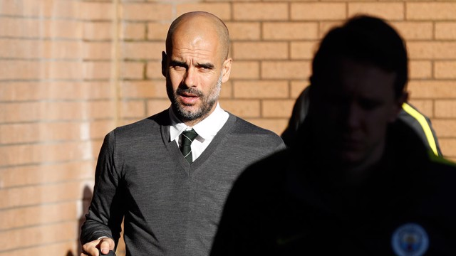 ARRIVAL: Guardiola steps off the coach