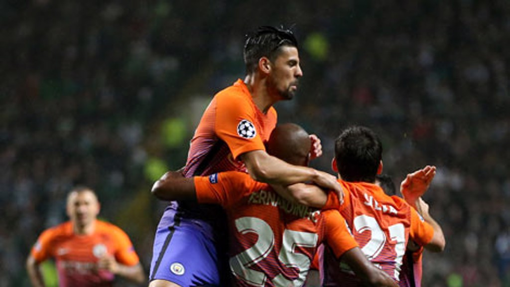 TEAM CELEBRATION: Manchester City's Fernandinho celebrates with teammates after scoring his side's first goal