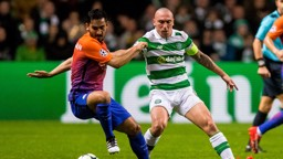COMPETE: Manchester City's Ilkay Gundogan and Celtic's Scott Brown compete for the ball