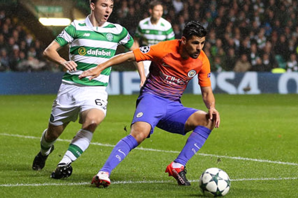 COMEPETE: Manchester City's Nolito and Celtic's Kieran Tierney battle for the ball