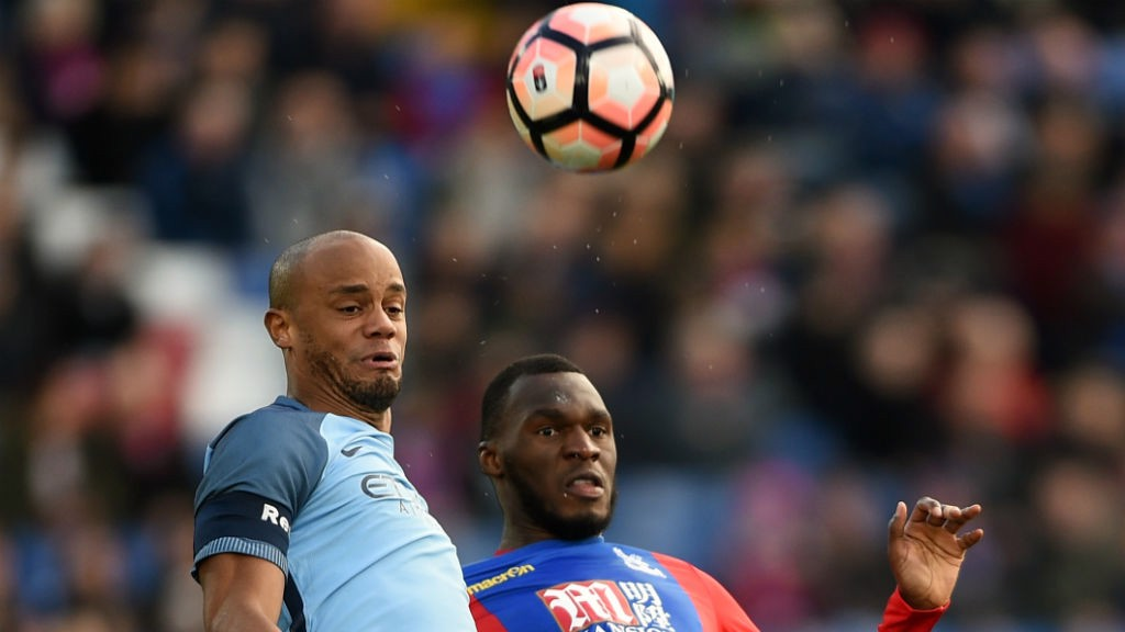PHYSICAL CHALLENGE: Kompany battles with Christian Benteke