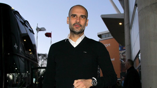 PEPPED UP: Guardiola arrives at the KCOM Stadium