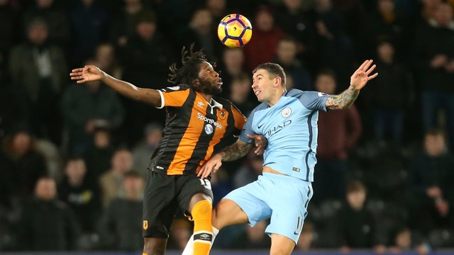HEADS UP: Aleksandar Kolarov and Dieumerci Mbokani challenge for the ball in the air