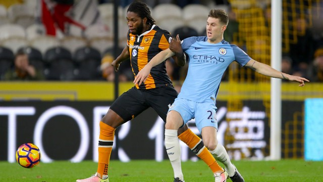 TUSSLING WITH A TIGER: Stones competes with Hull's Mbokani before his early substitution