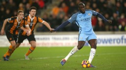 DECISIVE: Yaya Toure fires home the penalty earned by Sterling to put City ahead