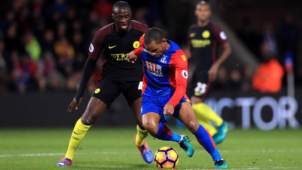 MIDFIELD DUEL - Yaya Toure and Jason Puncheon battle for the ball