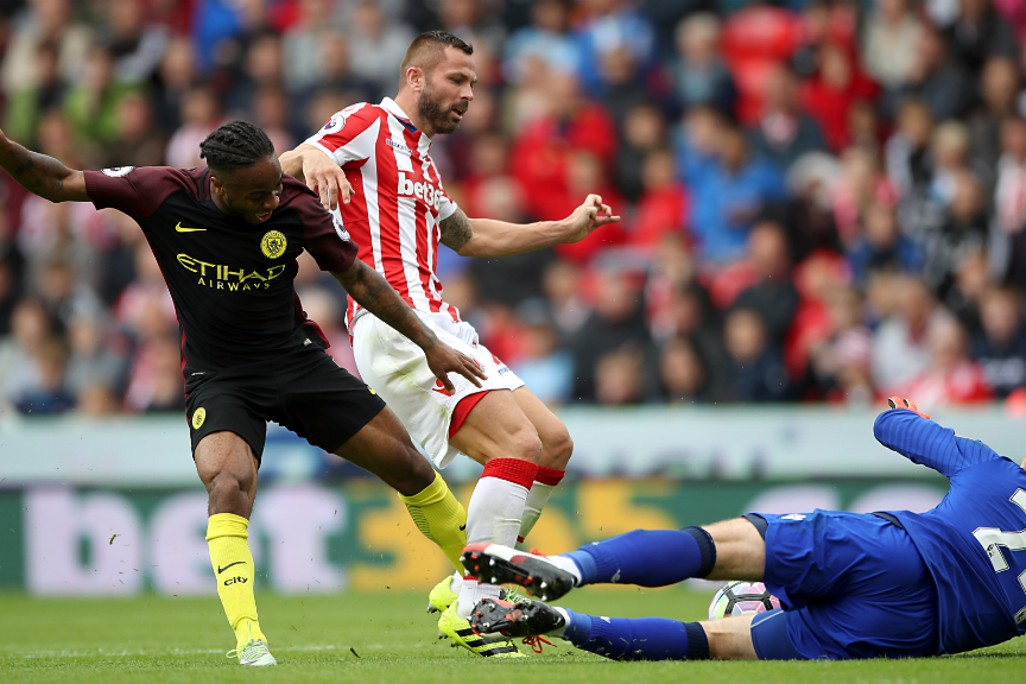 'KEEPER'S BALL: Shay Given smothers as Raheem Sterling looks to pounce