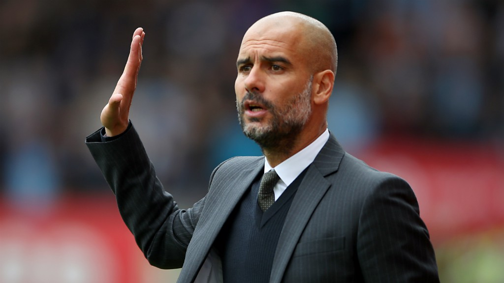 FOLLOW MY LEAD: Pep Guardiola delivers instructions from the touchline
