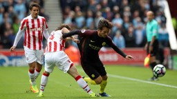 SILVA BULLET: David Silva attempts to escape the attentions of Joe Allen