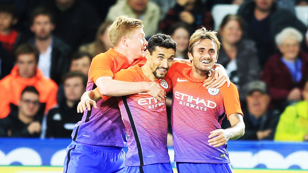 Aleix Garcia celebrates with Kevin De Bruyne and Jesus Navas