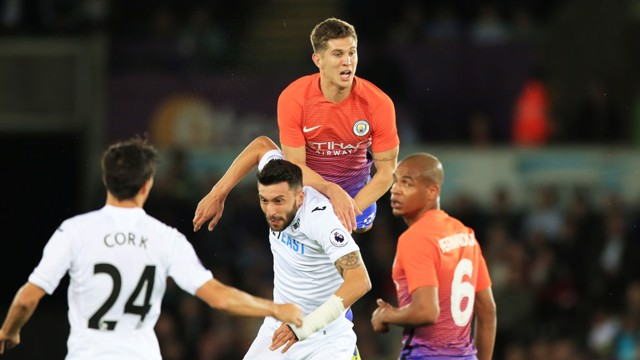 John Stones heads the ball