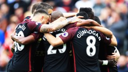 HUDDLE: The team celebrate Aguero's goal