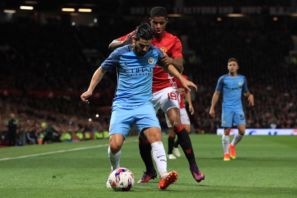 Nolito and Marcus Rashford battle for the ball.