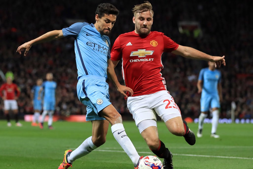 Jesus Navas battles for the ball with Luke Shaw