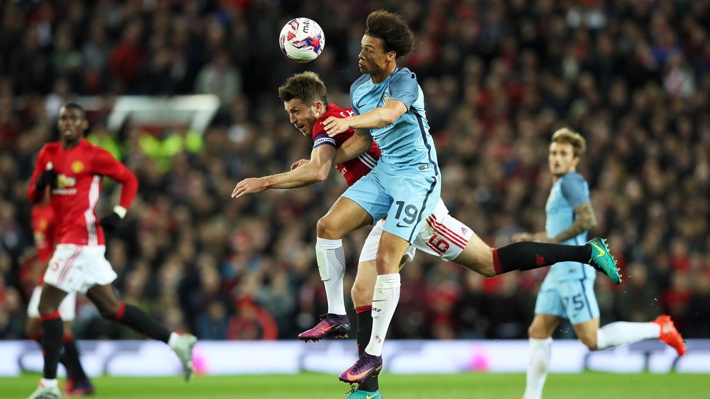 Leroy Sane beats Carrick to the ball