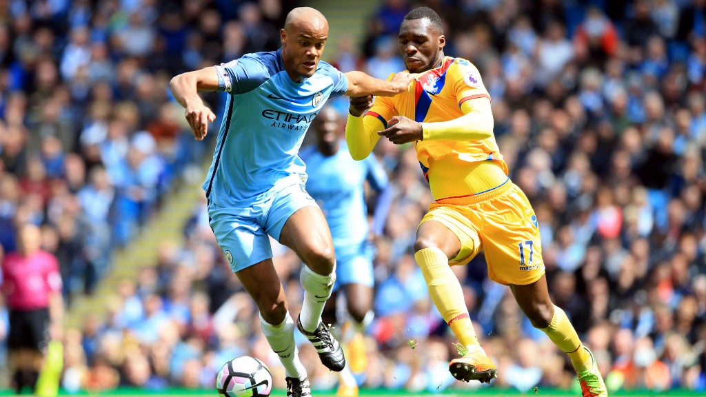 HEAVYWEIGHT CLASH: Kompany competes with Benteke for the ball.