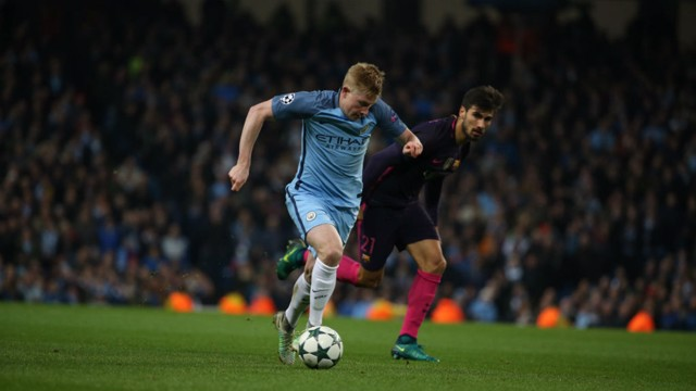 BREAK AWAY: De Bruyne moves past Andre Gomes in the midfield