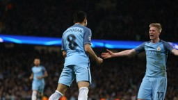 LETHAL: Ilkay and De Bruyne celebrate after the German scores City's third of the night
