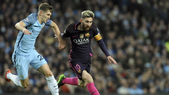 TOUCH TIGHT: John Stones keeps a close eye on Lionel Messi...