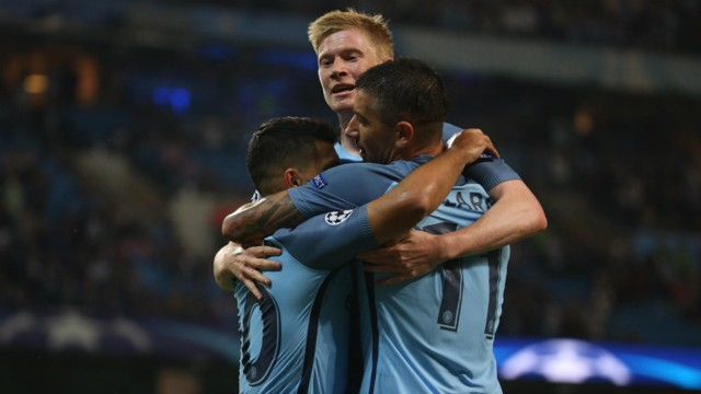 MOBBED: Aleks Kolarov and Kevin De Bruyne congratulate Aguero on his opener