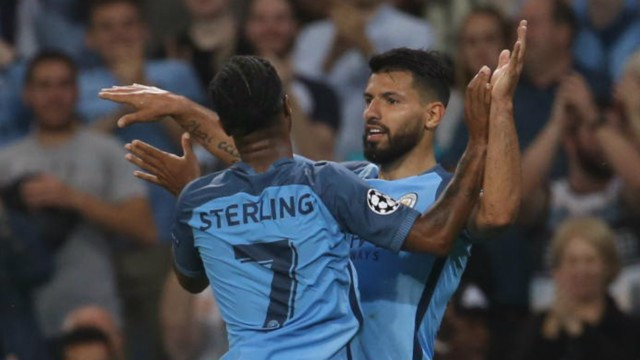 HAT-TRICK HERO: Kun and Raheem Sterling celebrate once more as Sergio Aguero nets his third of the evening
