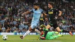 COMPOSURE: Sergio Aguero rounds the 'keeper and slots home for his treble