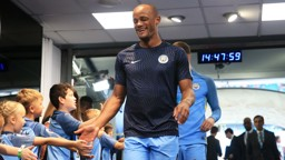 BIG SMILES: Vincent Kompany made his return to the match day squad in City's win over Bournemouth