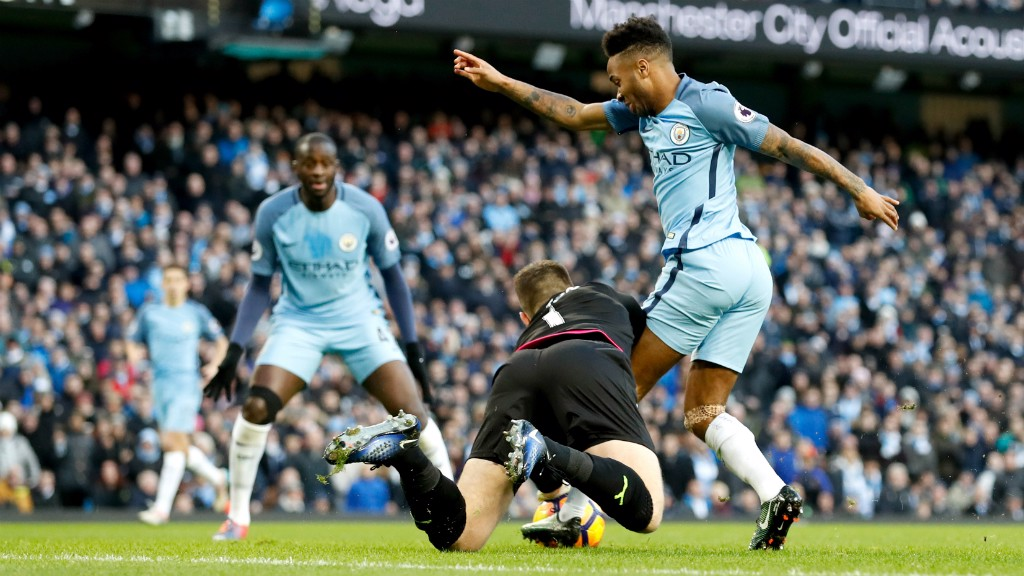 THWARTED: Tom Heaton does well to deny Raheem Sterling