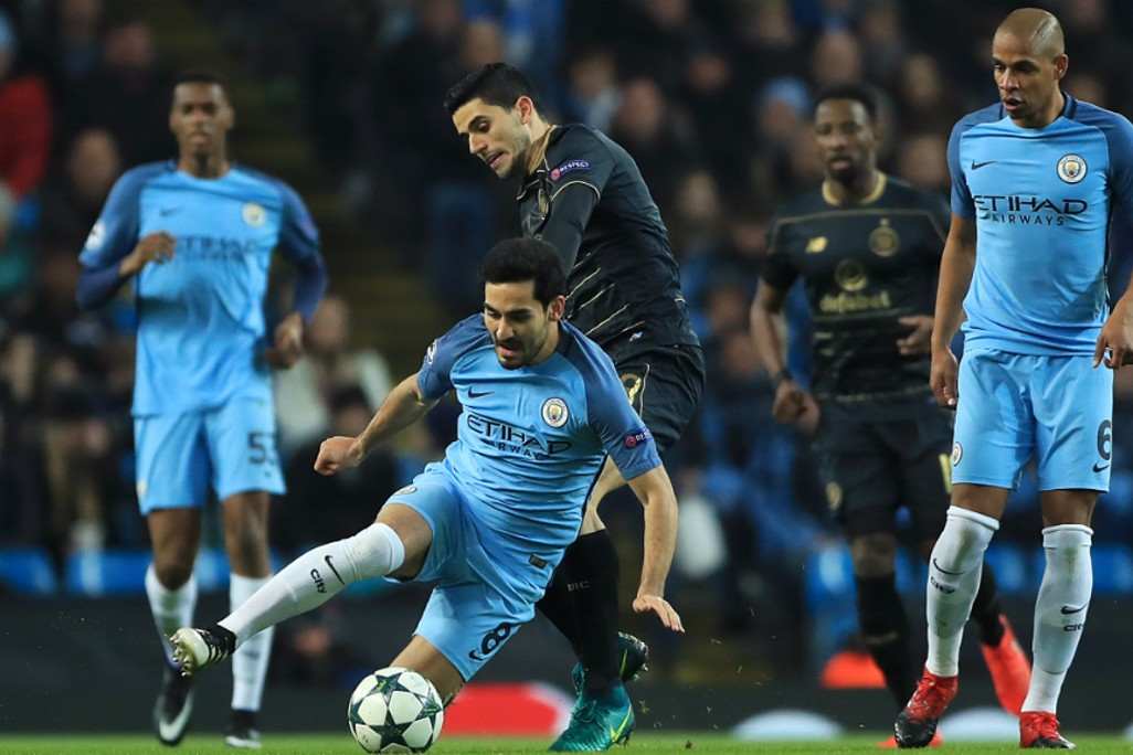 TACKLE: Ilkay Gundogan slides in to retrieve possession