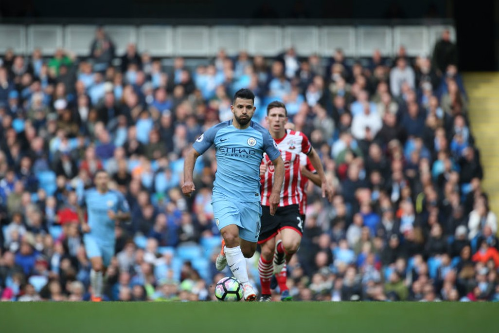POCKET ROCKET: Aguero powers forward into enemy territory