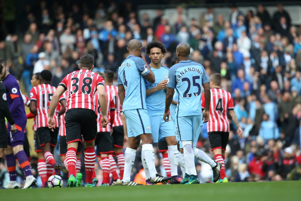 WORDS OF WISDOM: The returning captain passes advice on to Sane and Fernandinho