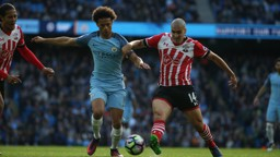 WINGING IT: Sane tries to find a way past Oriol Romeu during a spell of City possession