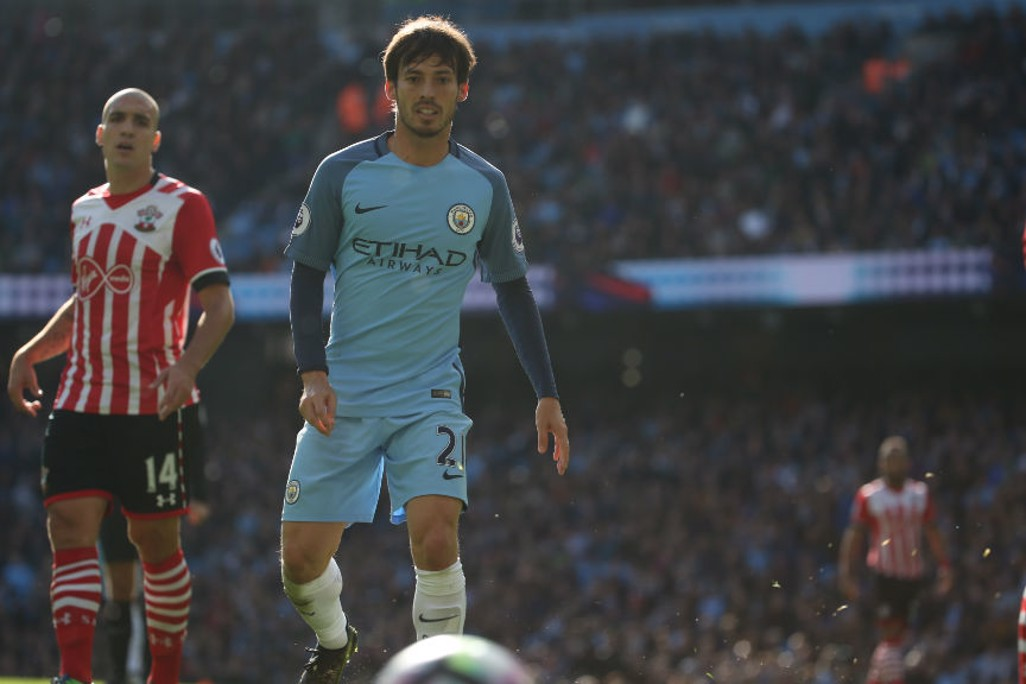 LOOKING ON: Another dangerous moment in the Saints box comes to nothing as David Silva looks on