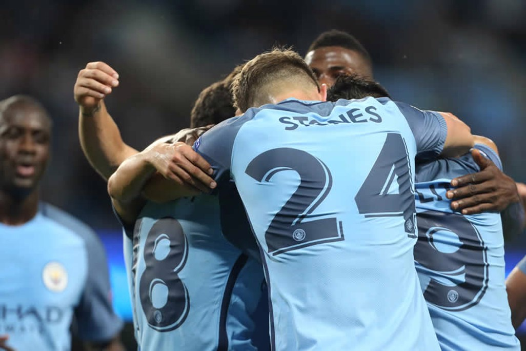 ALL TOGETHER NOW: Stones leads the celebrations
