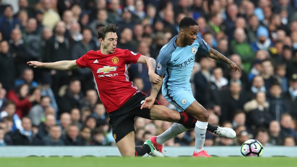 MIDFIELD BATTLE: Sterling and Matteo Darmian battle for possession.