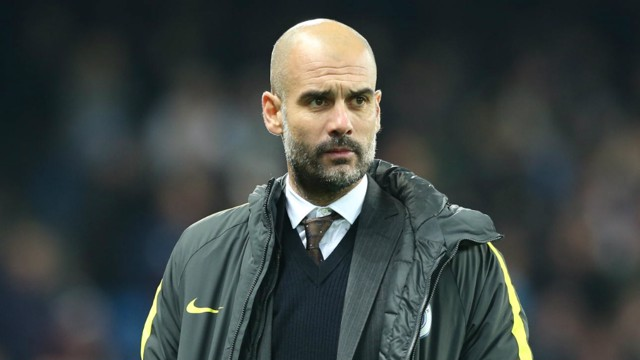 FOCUSED: Pep Guardiola examines proceedings