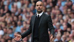BOSSING IT: Pep Guardiola issues instructions from the sidelines