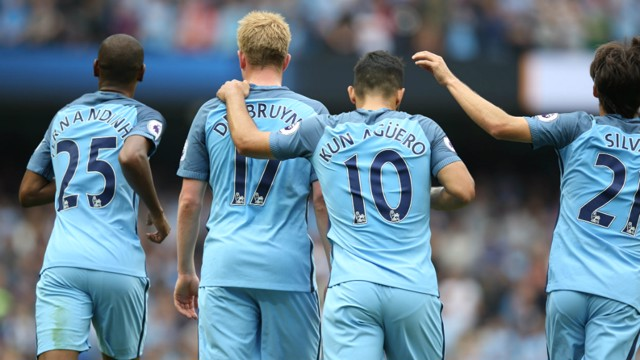 ASSIST KING: Kevin De Bruyne is congratulated on his superb cross for Fernandinho's goal