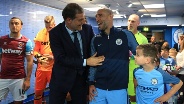 REUNITED: Slaven Bilic and Pablo Zabaleta catch up in the tunnel
