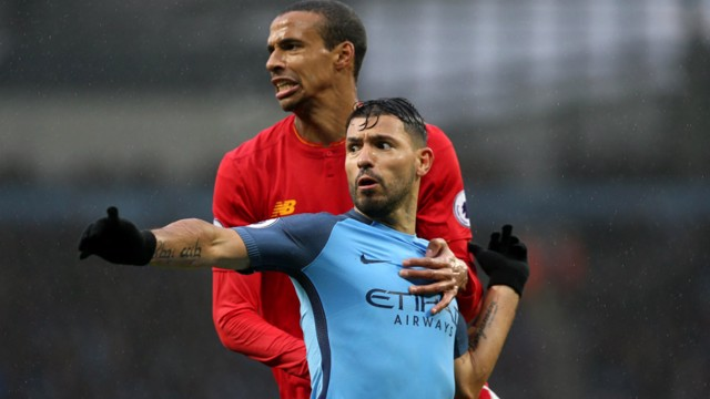 BATTLE: Joel Matip appeared to pull back Aguero