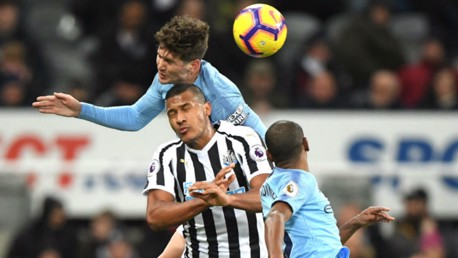 RISING HIGHEST: John Stones beats Salomon Rondon to an aerial ball